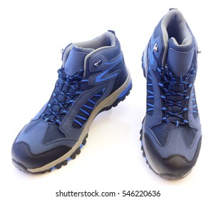 New trekking shoes isolated on white background closeup