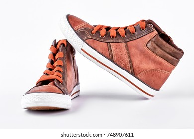 New trend leather brown sneakers. Fashion design sport trainers isolated on white background. Brand sport shoes.