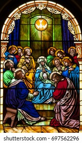 NEW TRIER, MN - August 16, 2017: Stained glass window in Church of St. Mary, depicting Pentecost, the coming of the Holy Spirit on Mary and the apostle