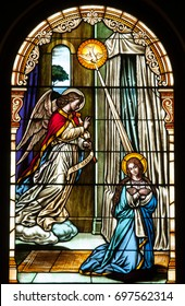 NEW TRIER, MN - August 16, 2017: Stained glass window in the Church of St, Mary, depicting the Annunciation, the angel Gabriel appearing to Mary to announce she would give birth to Jesus