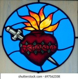NEW TRIER, MN - August 16, 2017: Round stained glass window in Church of St. Mary, depicting a heart pierced by a sword, symbol of Blessed Virgin Mary