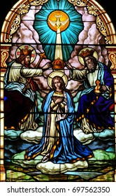 NEW TRIER, MN - August 16, 2017: Stained glass window in Church of St. Mary, depicting the crowning of the Blessed Virgin Mary as Queen of Heaven