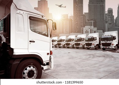 New truck fleet with city view.