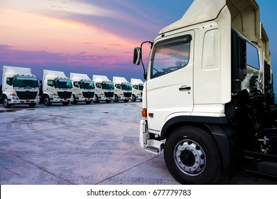 New truck fleet is parking and sunset background.