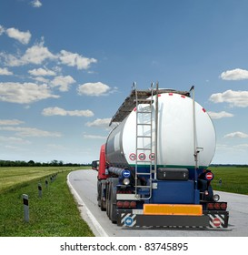 new truck with tank trailer driving the highway