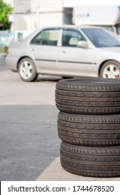 New tyres change swap with old tires outdoor service with blur old car vehicle.