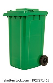 A new unbox green large plastic bin isolated on white background. Wheelie garbage container with a lid. Concept of cleaning, waste separation, and public hygiene.