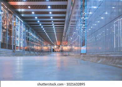 A new underground pedestrian crossing in gray with glass shops