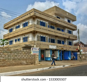 New unfinished office building with stores in West Africa. Development of business in Ghana. Construction industry. Architecture of Accra. Beautiful urban landscape. Ghana, Accra – January 11, 2017