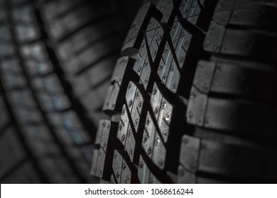 New and unused car tires against dark background
