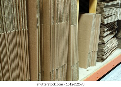New unused cardboard boxes in small online store warehouse.