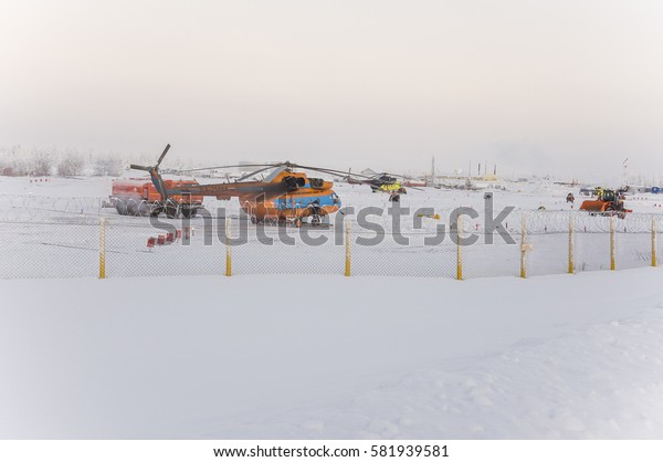 New Urengoy, YaNAO, North of Russia. Helicopter UTair and Konvers avia  in the local airport  on the service. January 06, 2016 Editorial