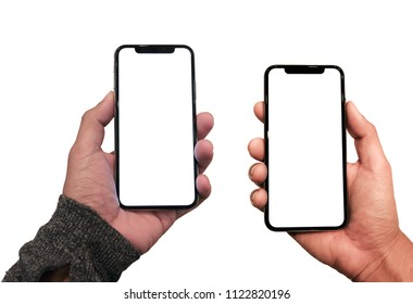 New version of black slim smartphone on hand similar to iphone x with blank white screen from Apple generation 10 , mockup model similar to iPhonex isolated on Background of digital economy.