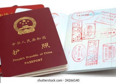 It is a new version passport of People's Republic of China. isolated. with a opening page, with Stamps.