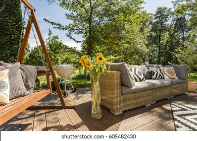New villa patio with wooden garden swing and rattan sofa
