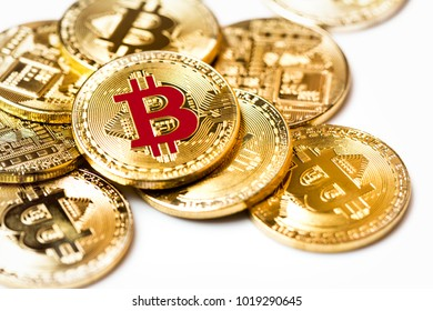 New virtual money crypto currency golden Bitcoin od white background.