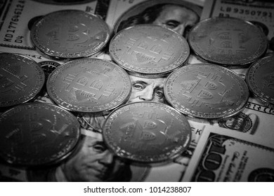 New virtual money Golden bitcoin coin on us dollars background . Cryptocurrency. Business and Trading concept. Close-up shot. black and white image
