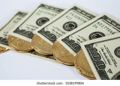 New virtual money Golden bitcoin coin on us dollars background . Cryptocurrency. Business and Trading concept.