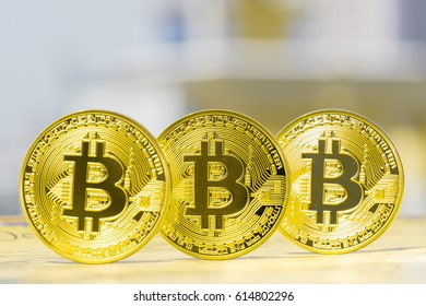 new virtual money, Golden Bitcoins with cityscape background.