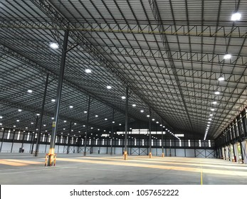 New warehouse for your business, Big Room for Product stock. Lighting on  empty warehouse