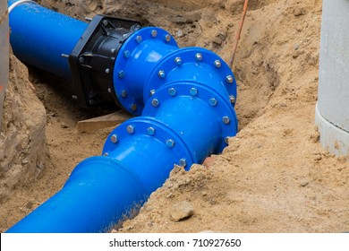 a new water pipe is being built in a pit