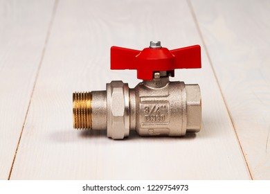 "New water valve with 3/4 "" thread size on light background."