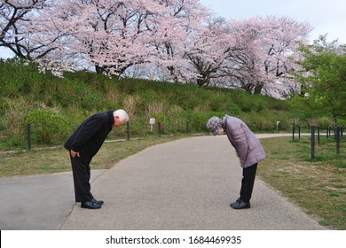 A new way of greeting to avoid the spread of coronavirus (COVID-19). Two Japanese people are bowing instead of hug or handshake. You can keep more distance than elbow bumping.