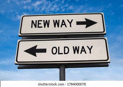 New way versus old way road sign. White two street signs with arrow on metal pole with word. Directional road. Crossroads Road Sign, Two Arrow. Blue sky background. Two way road sign with text.