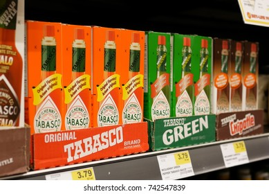 New Westminster, BC, Canada - April 15, 2017 : Close up display Tabasco red and green pepper sauce inside buy low foods store