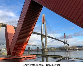 New Westminster, BC, Canada - February 4, 2018 : Great views of the city of New Westminster and Fraser River, Pattullo bridge and Sky-Train bridge with the WOW Westminster made by Four corten steel sh