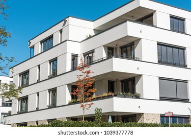 New white apartment house in front of a blue sky seen in Berlin, Germany