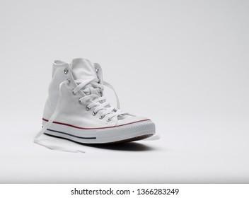 new white chucks on white background