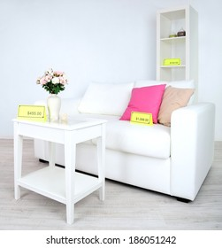 New white furniture with prices on light background