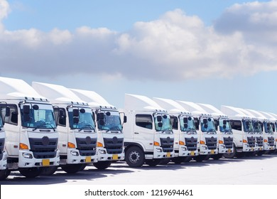 New white haulage truck fleet with beautiful blue sky background empty space.