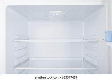 New white refrigerator isolated on white background
