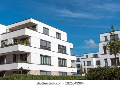 New white townhouses in front of a blue sky seen in Berlin, Germany