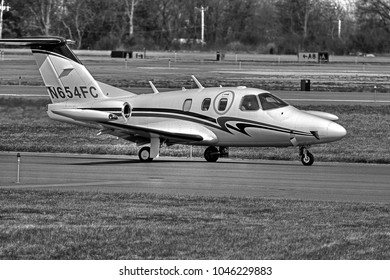 NEW WINDSOR, NEW YORK - APRIL 11, 2017: A 2008 Eclipse Aviation EA500 taxiing off the runway of Stewart International Airport. This airplane is a twin turbofan jet.