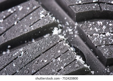 New winter tire covered with snow