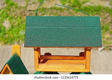 New wooden bird feed house with green roof
