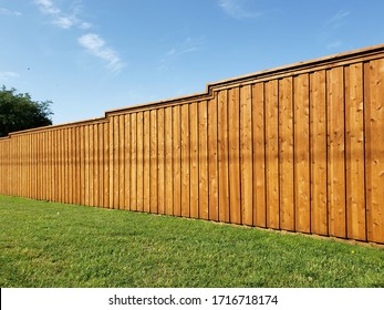 New wooden brown fence in community