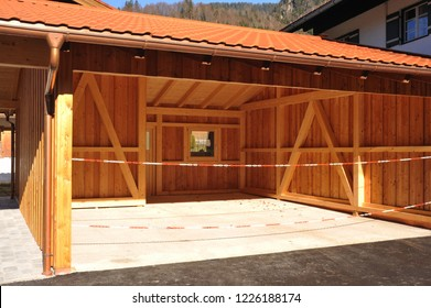 New wooden Carport with Copper Rain gutter, rainwater pipe and Connector Nozzle at tiled Roof. Alpine Architecture
