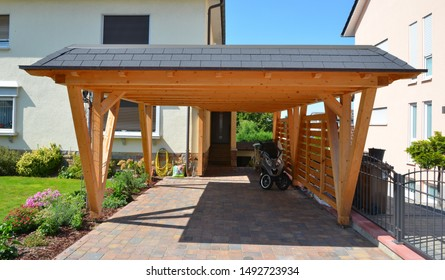 New wooden Carport in Front of a residential Building