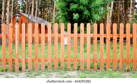 New wooden fence in the garden