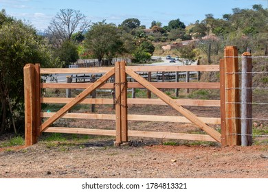 new wooden gate with chain and padlock