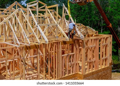 New wooden house from natural materials under construction. Close-up detail of attic roof frame construction