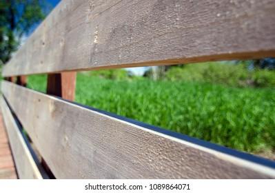 New wooden rails cand planks at bridge on Heron Loop trail, Marymoor, Redmond, Washington