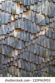 New wooden roof shingles background.
