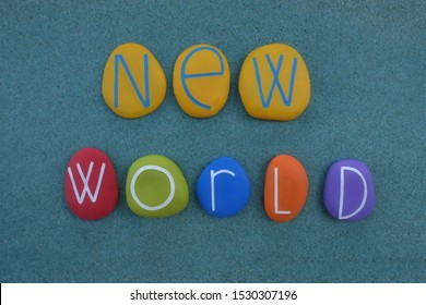 New World for a better future, creative text composed with multicolored stones over green sand