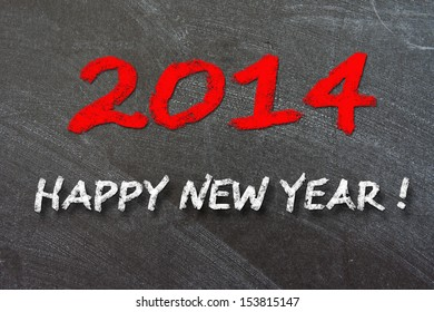 New year 2014 vintage chalk text label on a blackboard