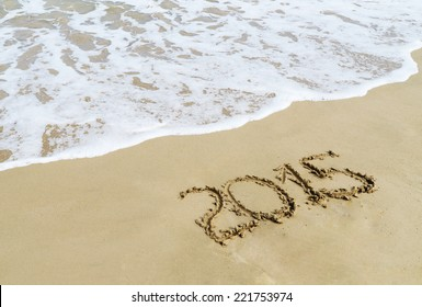 new year 2015 digits on  beach sand